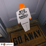 tiny trump with the stamp 'Big Buillies Are Small People' on a doormat that says 'Go Away'