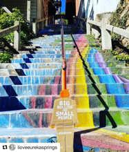 tiny trump with the stamp 'Big Bullies Are Small People' at the rainbows steps in Euraka Springs, Arkansas