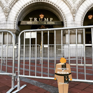 tiny trump with the stamp 'Property of Russia' in front of the Trump Hotel in Washington D.C.