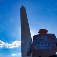 tiny trump in front of the Washington Monument